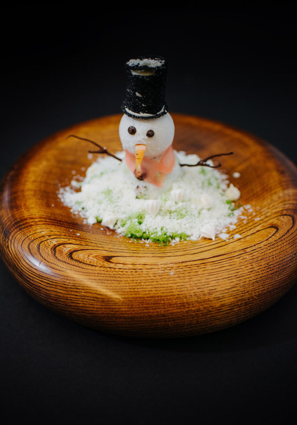 Snowman dessert on wooden bowl