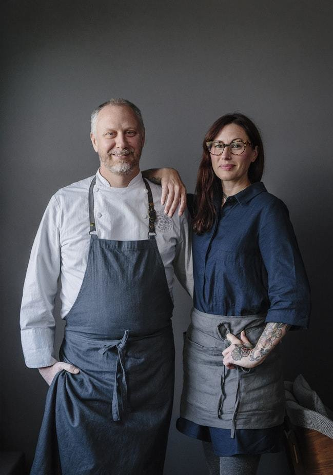 Chef Kyle Connaughton and Wife/ Head Farmer Katina with grey background