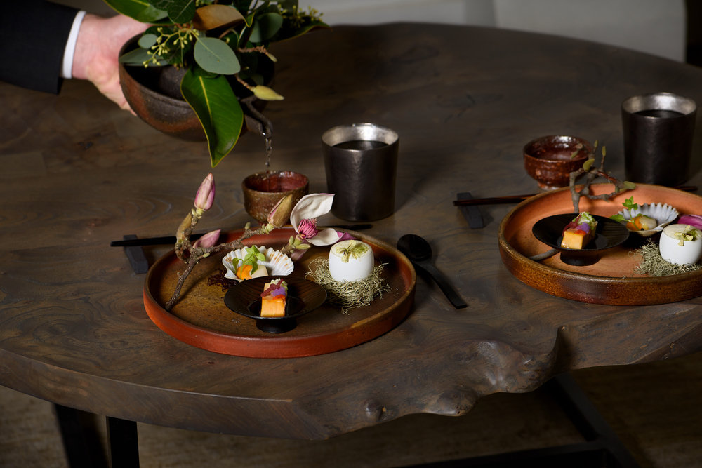 sake service and first light bites offered for in-room dining