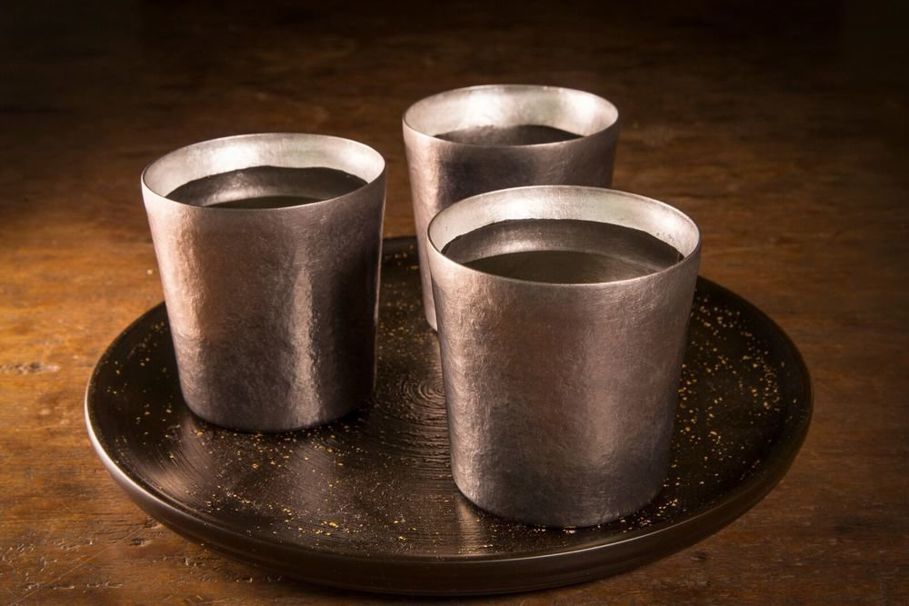 Hand-hammered titanium water cups made by artisans at SUS Gallery of Niigata