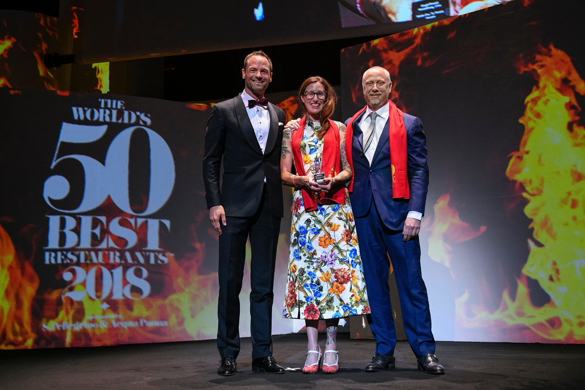 "Chef Kyle Connaughton and wife/ Farmer Katina on stage in Bilbao, Spain, accepting the ""Miele One to Watch Award"""